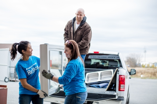 A contractor drops off a truck load of donated items