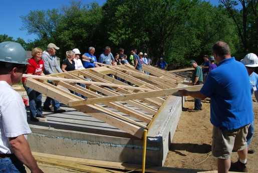 Habitat volunteers and staff erect a wall in Benzie County
