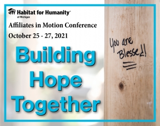 "On the right, a black logo reads ""Habitat for Humanity of Michigan."" Underneath that, black text reads ""Affiliates in Motion Conference, October 25-27 2021."" Blue Text beneath that reads ""Building Hope Together."" On the left, the picture of a wall stud, with a handwritten message on it, reading ""You are Blessed!"""
