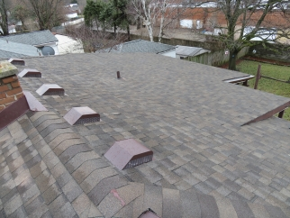 shot of a roof with new gray shingles that was repaired with the Priority Home Repair Program
