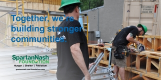 volunteers on a Habitat build site carry pipes and work with a circular saw with text from SpartanNash