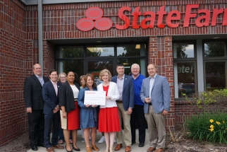 Representatives from Habitat Michigan, State Farm, and MI Legislators in front of State Farm sign