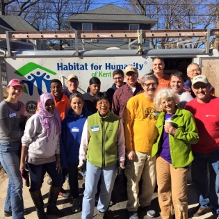 Volunteers and staff in front of Habitat for Humanity of Kent County trailer